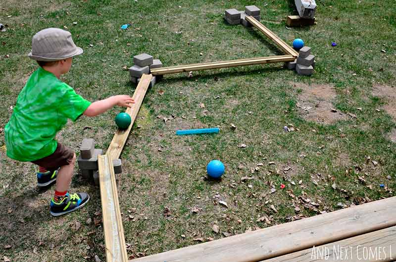 building-with-loose-parts-outdoors-diy-ball-run-kids-2